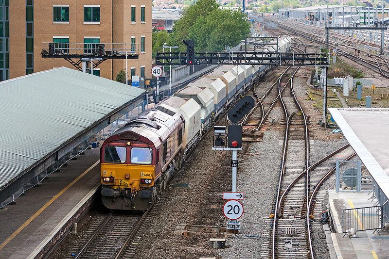 16th May 13:  The Whatley to St Pancras Curch Yard Sidings ( 6M20)  loaded stone is in the hands of 66023 . Using the old National Power hoppers it runs through platform 7, the old Down Main platform, at Reading