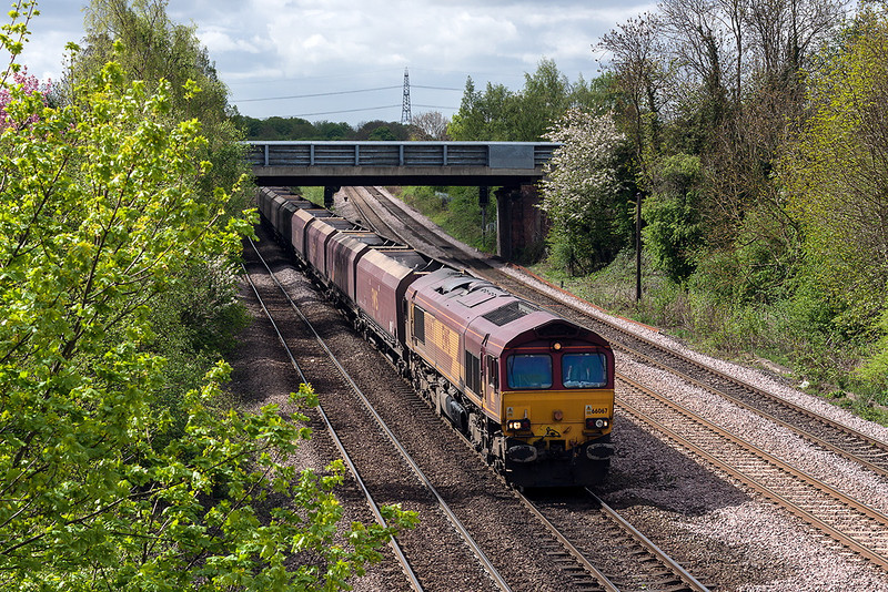 9th May 13:  Catching some welcome sun shine is 66067 on coal empties.  It ran through towards Colton Junction