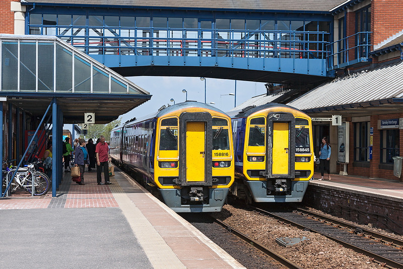 7th May 13:  158816 on the 12.50 Sheffield to Leeds crosses 159845 on the 12.37 Leeds Sheffield at Barnsley