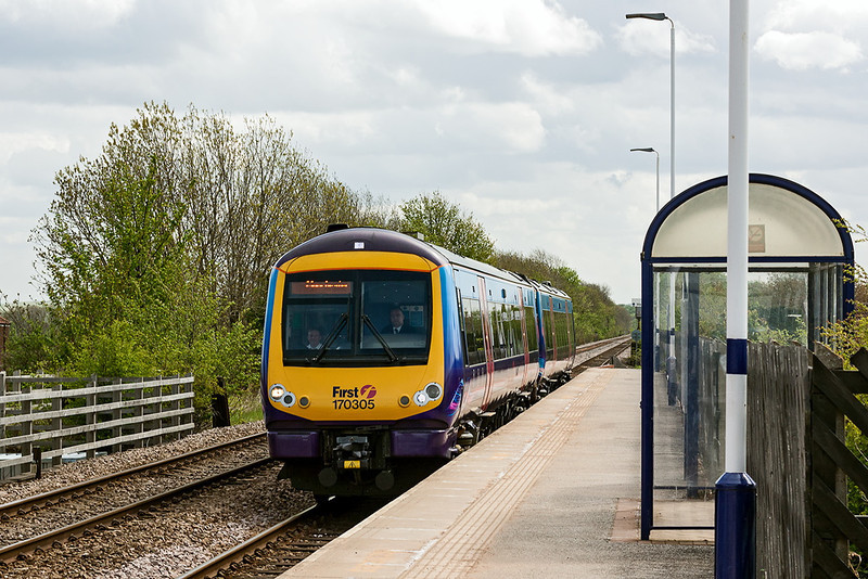 9th MAy 13:  Originally with South West Trains and now used  by Trans Pennine 170305 flashes through South Milford while working the 10.40 from Hull to manchester Piccadiilly