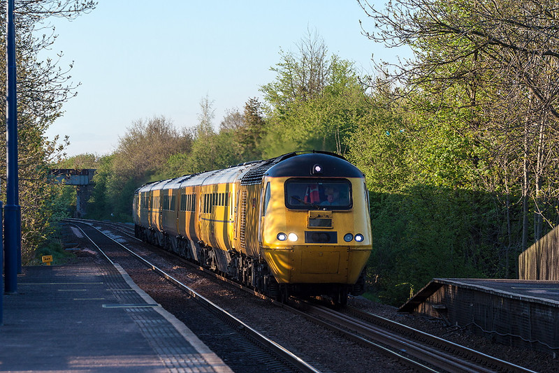 6th May 13:  At 7.42 pm with shadows almost covering the line through Thurnscoe the  Network Rail NMT races south.  43062 'John Armitt' leading