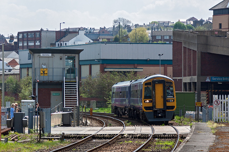 7th May 13:  158816 curves into Barnsley working 1L84 the 12.50 from Sheffield to Leeds
