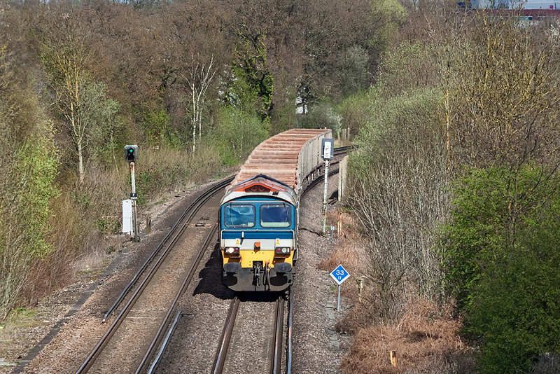 26th Apr 13:  59104 is again in charge of the 10.58 from Grain to Merehead (7Z20) and as usual is running over an hour late as it reaches Amen Corner in Bracknell