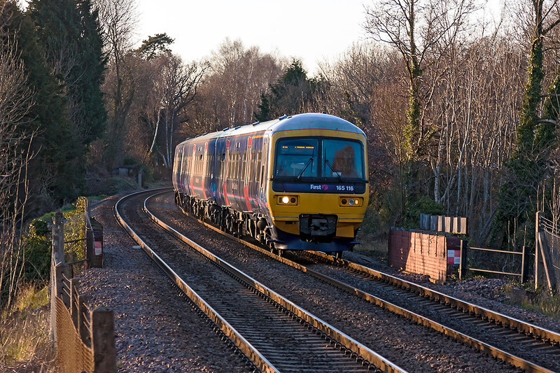 2nd Apr 13:  Catching some evening sun rays is 165116 at Sandhurst with 1O47 the 18.34 Reading to Gatwick Airport
