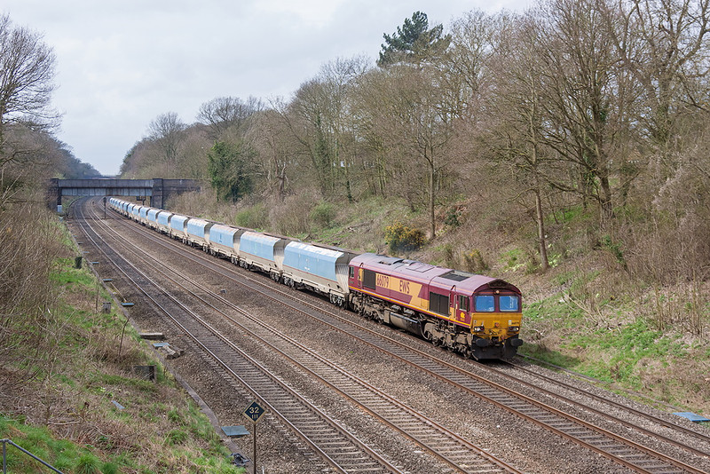 17th Apr 13:  Running under Butts Hill Road bridge in the Sonning Cutting is 66079 heading 6M20 from Whatley to St Pnacras.