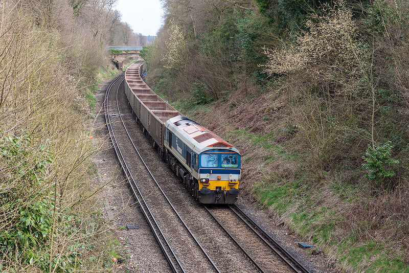 17th Apr 13:  Running through Bracknell is 59103 heading  7Z20 the 10.58 Grain to Merehead empty boxes