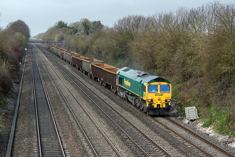 15th Apr 13:  Running nearly 20 minutes late through Shottesbrooke is 66604 on the point of 6Z33 empty scrap wagons from Cardiff Tidal to Dagenham.