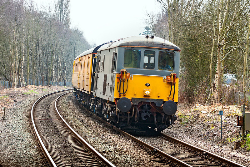 8th Apr 13:  Leaning on the curve into Blackwater is 73107 heading 1Q02 from Guildford to Reading.  73201 is on the other end.