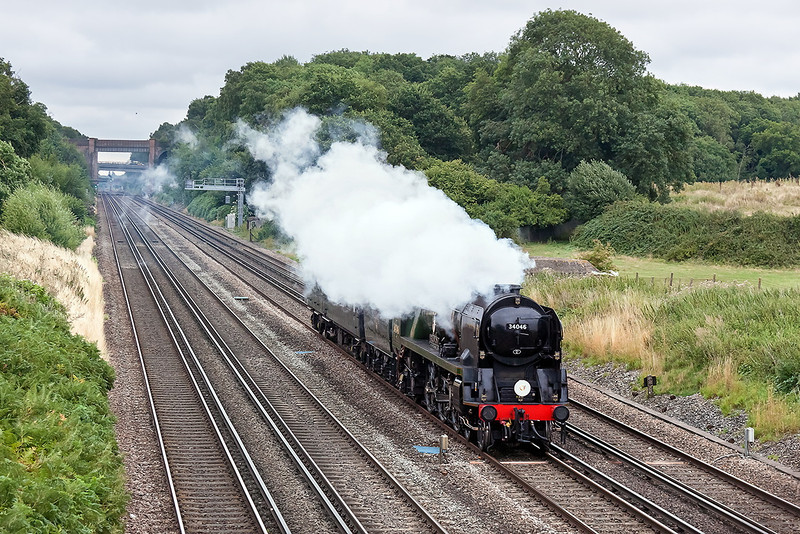 16th Aug 13:  With the steam blowing down at just the wrong moment 34046 'Braunton', running as  5Z81 from Southall to Bristol Kingsland Road, passes Totters Lane on the fast