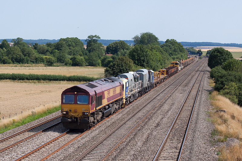 1st Aug 13:  Power for the afternoon Eastleigh to Hinksey Departmental is  provided br 66056.  With a Windhoff week killer unit in the consist the train is pictured with Cholsey station in the background