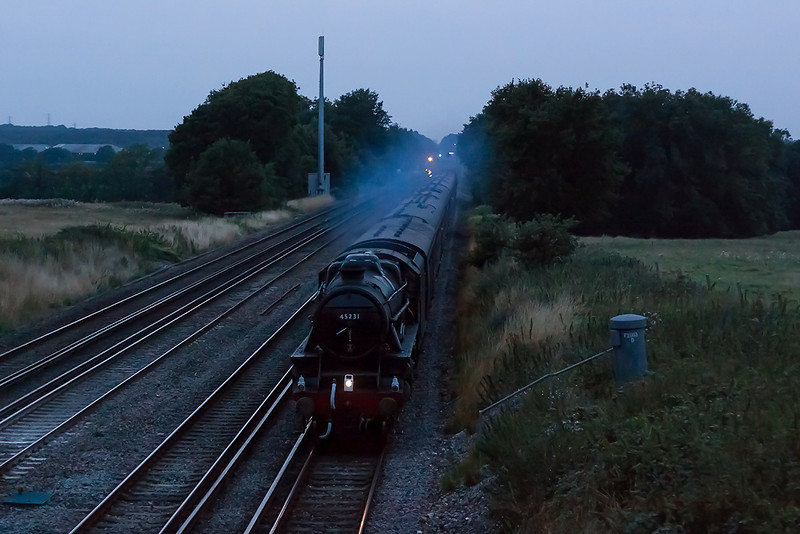 28th Aug 13:  At twelve minutes past eight and with the light fading fast  LMS Black 5  #45231 in charge of 1Z69 'The Dorset Coast Express' from Weymouth to Waterloo is pictured between Hook and Winchfield