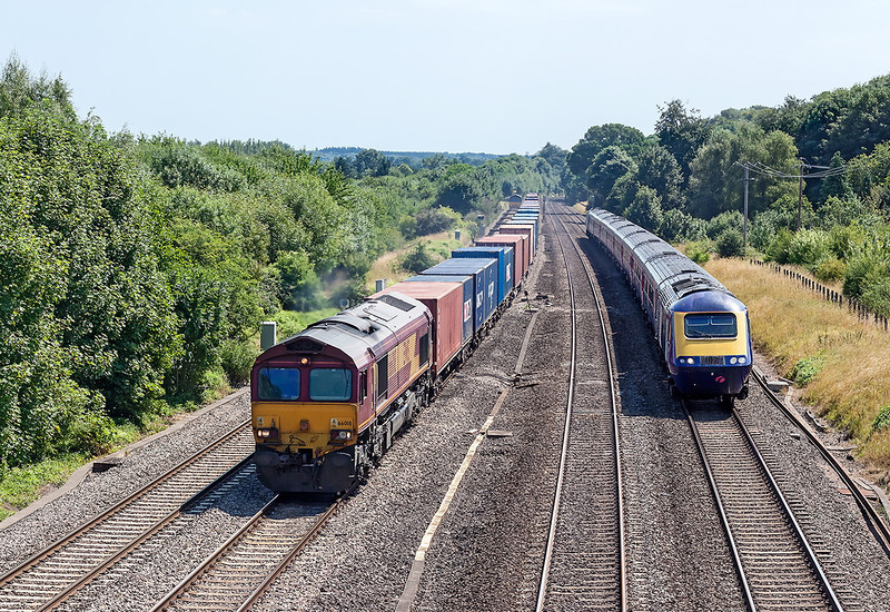 1st Aug 13:  66018 on the Southampton to Birch Coppice is being overtaken by the late running 12.45 Paddington to Swansea at Lower Basildon