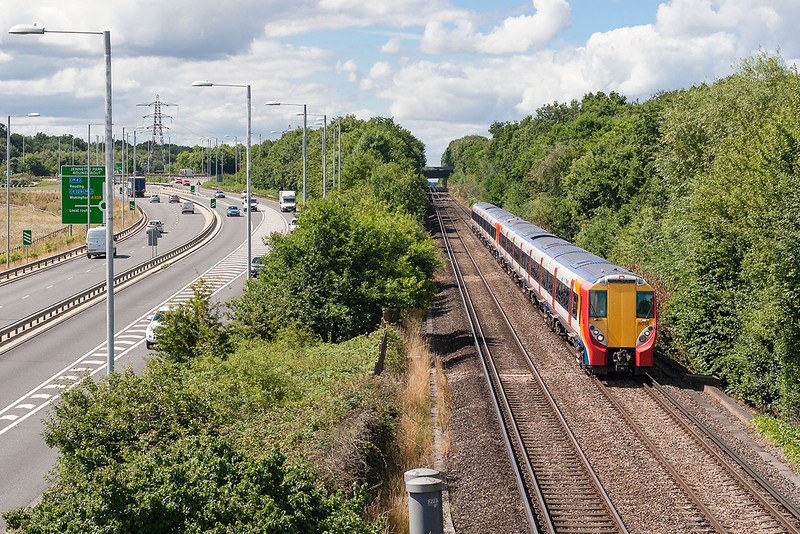 9th Aug 13:  The 12.12 from Reading to Waterloo formed of 458014 & 458007 nearing Bracknell