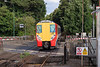 10th Aug 13:  458014 is crossing the A30 road as it enters Sunningdale with the 17.20 from Waterloo to Reading