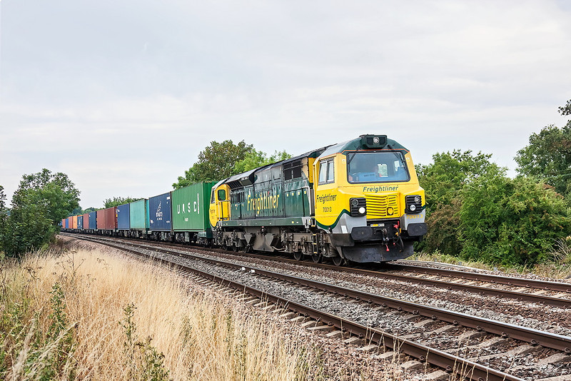 23rd Aug 13:  Although the sun had departed it was still fairly bright as 70013 storms away from Mortimer with 4M61  from Southamptom Maritime to Trafford Park