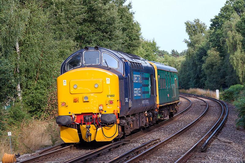 21st Aug 13:  On the homeward leg of 2Z02s trip from Clapham to Clapham via Weymouth, Westbury, Salisbury anf Reading 37402 pushes Caroline away from Bracknell