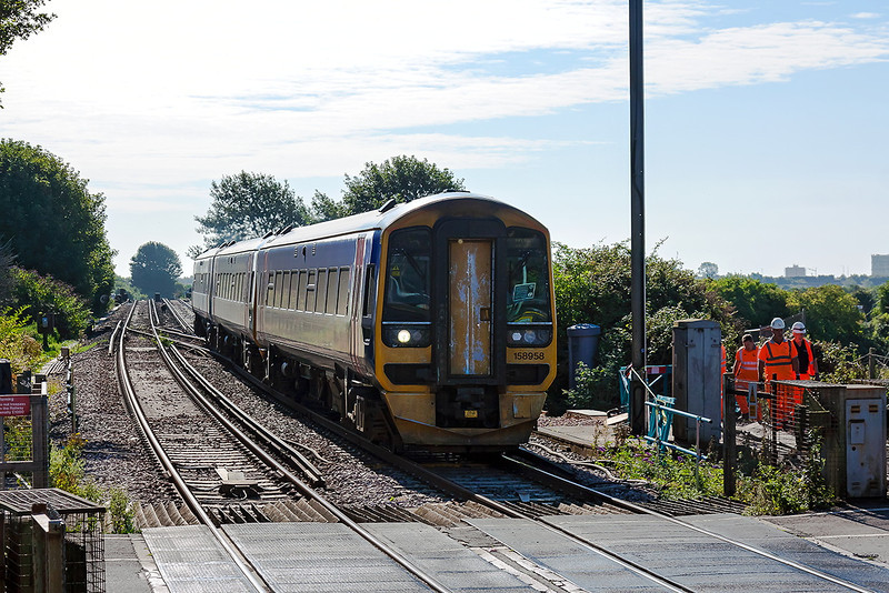 20th Aug 13:  It is 09.32 and 1V94 the 08.59 First Great Western service from Bighton to Great Malvern rattles over the level crossing at Ford