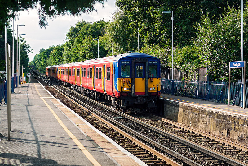 10th Aug 13:  455917 leads on 1Z12 the 18.00 Ascot Race Special non stop to Waterloo.  Captured 2 minutes into the journey at Sunningdale