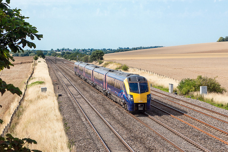 1st Aug 13:  With North Moreton in the distance 180108 forming 1P57 the 14.26 from Great Malvern to Paddington sreams  past Manor Farm in Cholsey