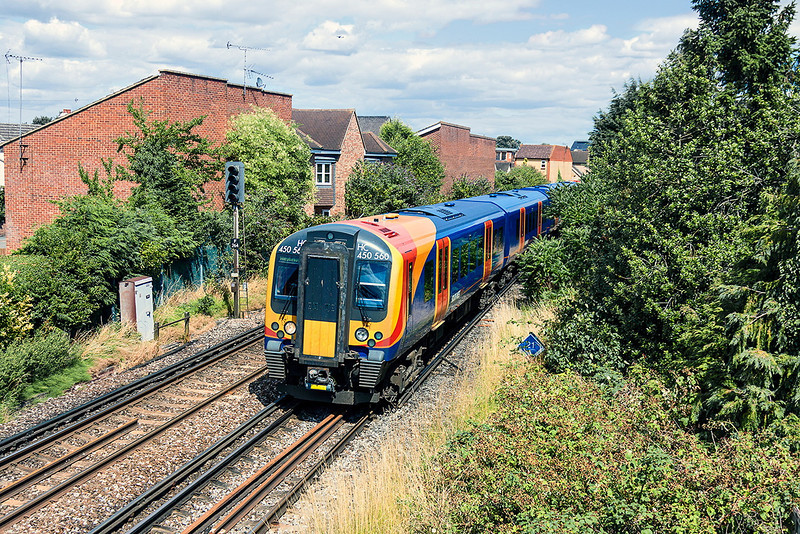 12th Aug 13:  The 12.50 from Waterloo to Weybridge departing Egham in the hands of 450560