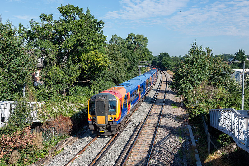 14th Aug 13:  450121 forming 2S22 the 09.03 from Weybridge to Waterloo passes the site of the old level crossing at Coxes lock