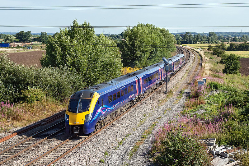 1st Aug 13:  180102 at Didcot North Junction  as 1P27 the 09.01 Oxford to Paddington.  If you are fit and able it is possible to get down  the embankment to the right of the bridge to avoid the wire.  Regrettably I can no longer fo this.