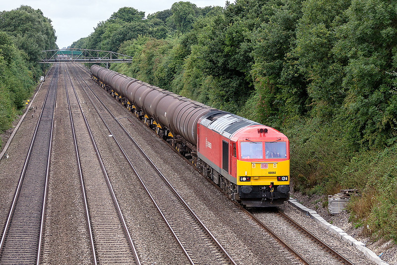18th Aug 13:  Running rather late due to over running engineering work at Reading 60092 plods east on 6A70 from Didcot to Colnbrooke.  Pictured at Shottesbrooke