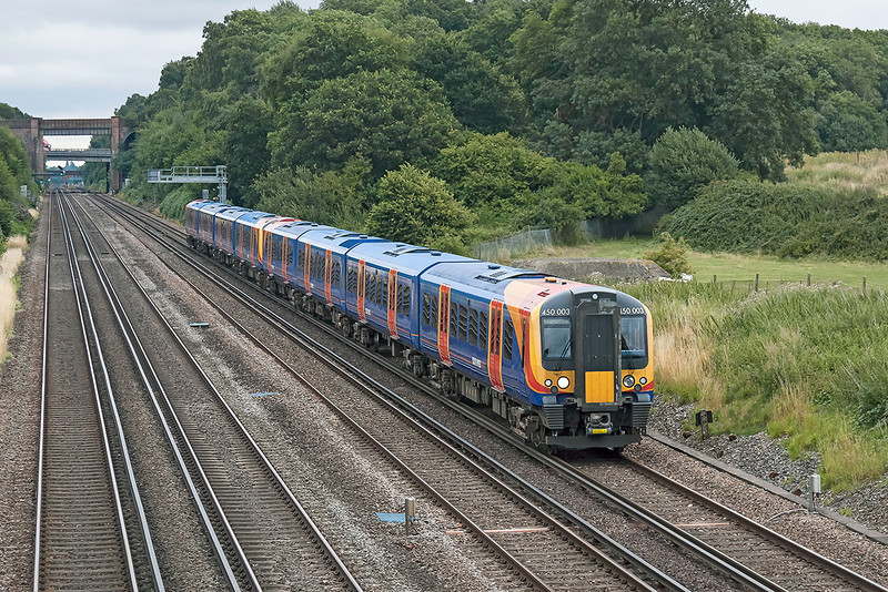 16th Aug 13:  Two of my nead to picture on one train 450003 leads 450097 on 2L33 the 12.12 from Waterloo to Basingstoke.  Seen at Totters Lane between Winchfield and Hook