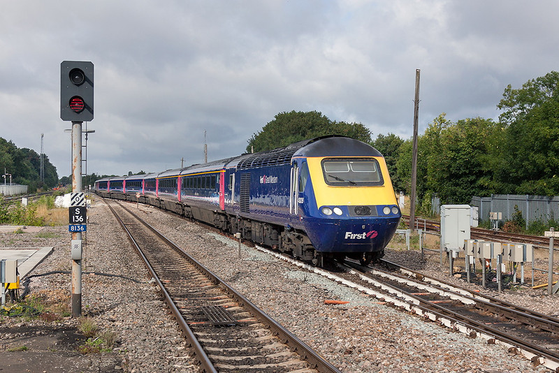 18th Aug 13:  1C05 the 07.57 Paddington to Penzance  formed of 43148 & 43128 has been terminated at Maidenhead. With the main lines blocked (see the High Viz on the left) over running engineering work at Reading has temporarily forced a total closure.  The train is to return to Paddington complete with passengers and is pictured here as it crosses to the Up Relief at Maidenhead