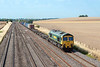 1st Aug 13:  66517 making for Southampton  passes the wheat fields at Manor Farm in Cholsey  with 4O09 from Trafford Park