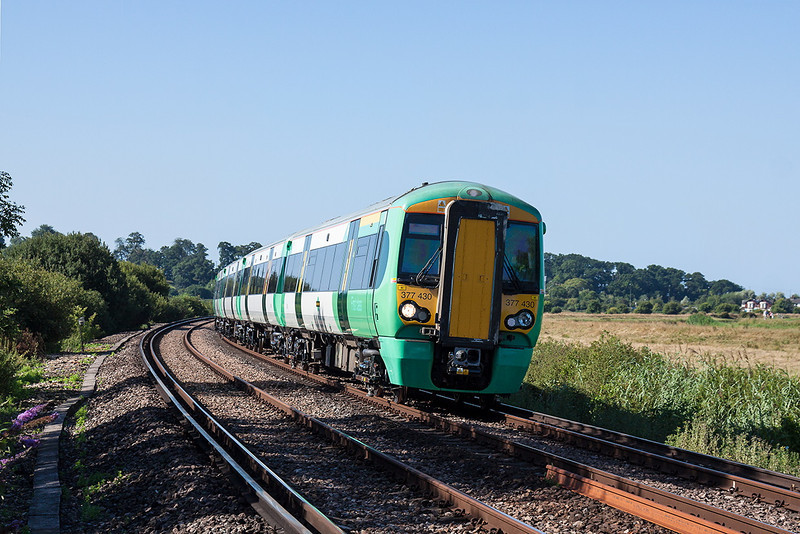 20th Aug 13:  Racing through Warningcamp is 377430 on 1C23 the 09.30 from Bognor Regis to Victoria