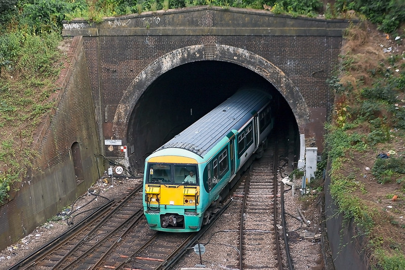 4th Aug 13:  456016 exits the 726 yd Crystal Palace Tunnel with 2S60 the 07.52 Victoria to Sutton