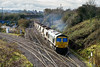 17th Dec 13:  6M40 the 11.56 Westbury to Stud Farm  in the hands of 66617 is captured at Hawkeridge Junction