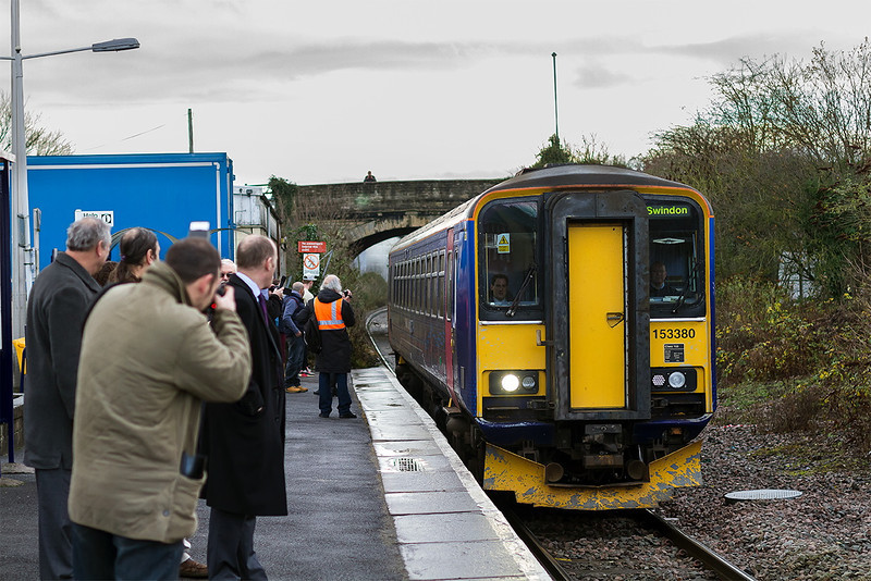 8th Dec 13: 153380  forming 2M07 the 10.32 from Westbury to Swindon arrives at Melksham.  Representatives of FGW and all the orginisations involved  in setting up this new dailly service were ther in force.