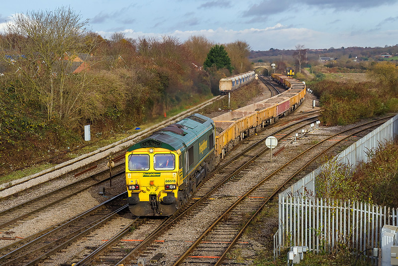 8th Dec  13:  Catching some sun as it arrives at it's destination is 66513 and 6Y12 from Horton Road to Westbury