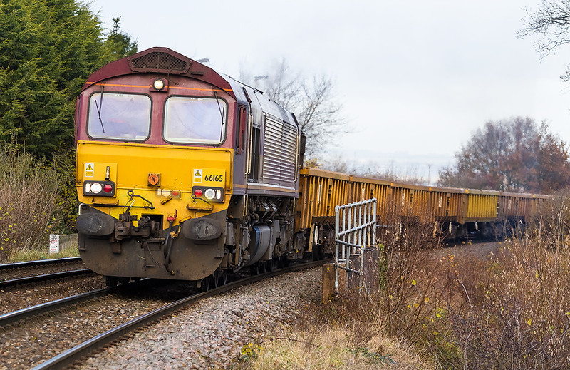 6th Dec 13:  66165 lifts the morning Departmental from Westbury to Eastleigh through Dilton Marsh