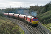 28th Dec 13:  Having worked sown the Berks & Hants with 6B33 the Murco emptirs from Theale to Robeston 60040 joins the line to Bristol at Hawkeridge Junction on the edge of Westbury