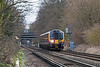 14th Feb 13:  450562 is captured crossing Chertsey Meads working 2S36 the 12.33 from Weybridge to Waterloo.  Addlestone Station is visible under the A318 Chertsey Road bridge