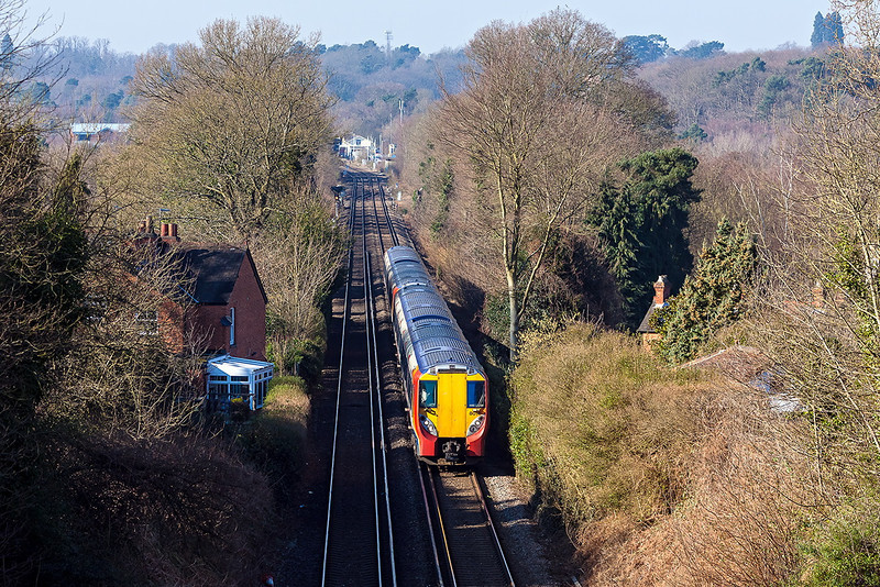 19th Feb 13:  458014 leads on 2C36 the 12.12 Reading to Waterloo pictured climbing through Sunnnghill.   Ascot station can be seen in the distance