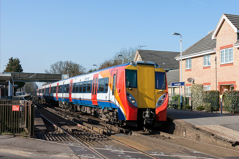 19th Feb 13: Just starting away from Sunningdale is the 13.12 from Reading.  458003 is due to arrive in Waterloo at 14.31