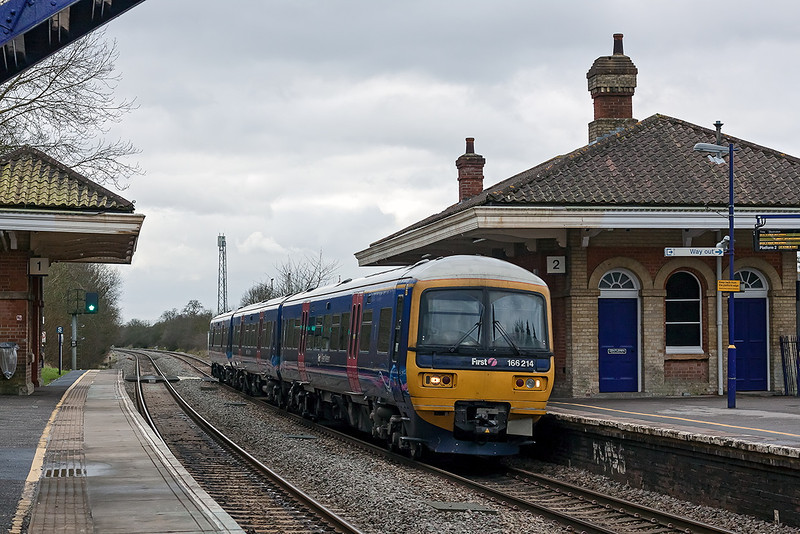 6th Feb 13:  The 11.36 from Basingstoke to Reading calls at Mortimer.  It is most unusual to see a Class 166 Turbo rostered for this duty