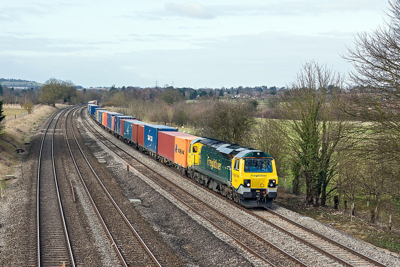 The standard view of East bound services at Lower Basildon sees 70019 on the point of  4O27 from Garston to Southampton