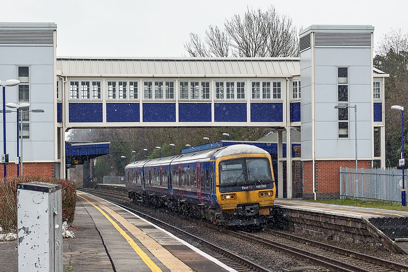 27th Feb 13: With light snow falling 166202 races through Twyford's platform 1 while working 1D27 the 10.50 from Paddington to Oxford