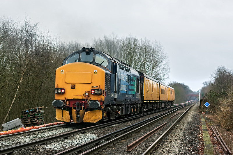 7th Jan 13:  I was expecting 3Q01 from Derby to Woking to be powered by 31223 so it was a nice surprise when 37423 opened up on the rear as she powered away from Virginia Water and crosses the M3