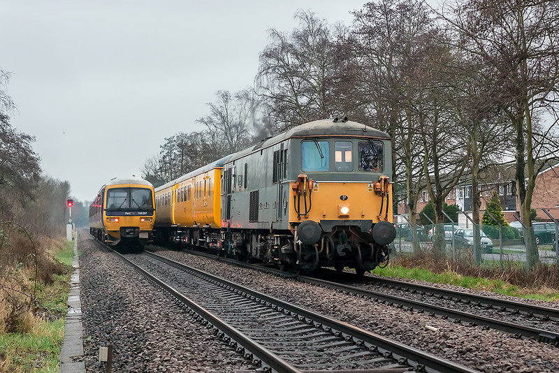 9th Jan 13:  1Q38 is running from Hither Green to Hither Green via Guildford, Reading and Portsmouth.  73107 TnT with 73201 are captured in dire light at Blackwater.  1/500 @ f3.2,  iso 1600.  166207 is working the 08.34 Reading to Gatwick service