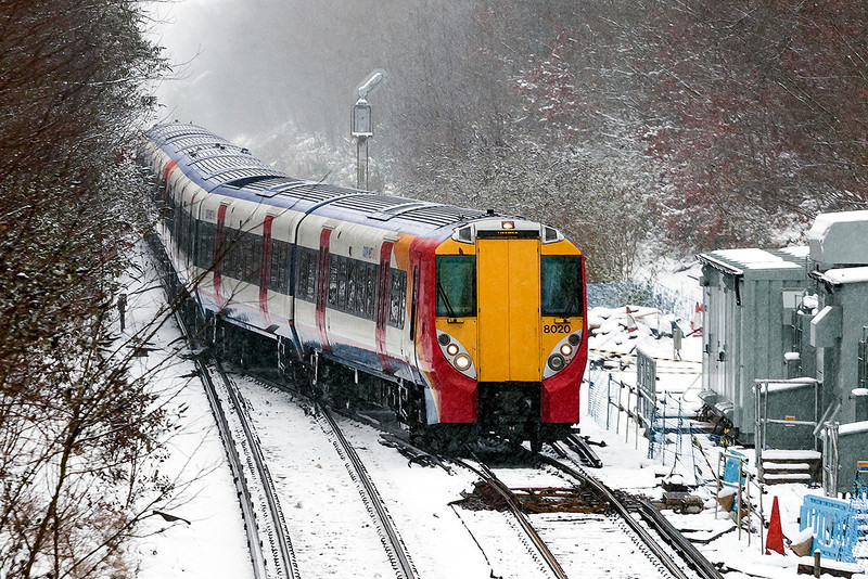 20th Jan 13: Due to the line to Waterloo via Staines being closed Reading sevrices were diverted via Wimbledon with a reversal at Virginia Water.    Exactly on time the 12.39 from Waterloo uses the crossover to gain access to platform 2 and to continue to Reading