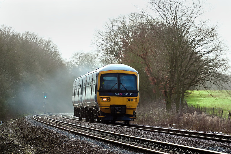 26th Jan 13:  Running late due to an incident at Reading West 165127 forming the 13.07 from Basingstoke to Reading nears Danes Crossing