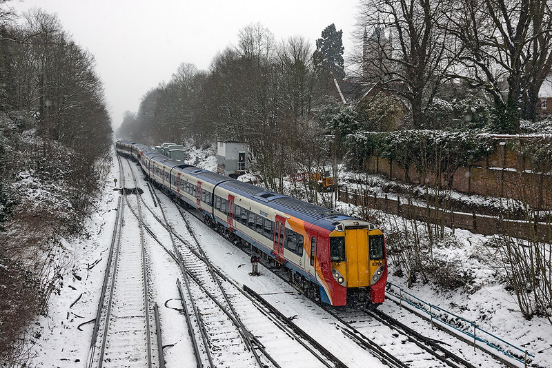 20th Jan 13:  458010 forming 2C36 the 12.24 from Reading to Waterloo is gaining access to the Chertsey line as the Reading services are being diverted via Wimbledon due to Engineering work.