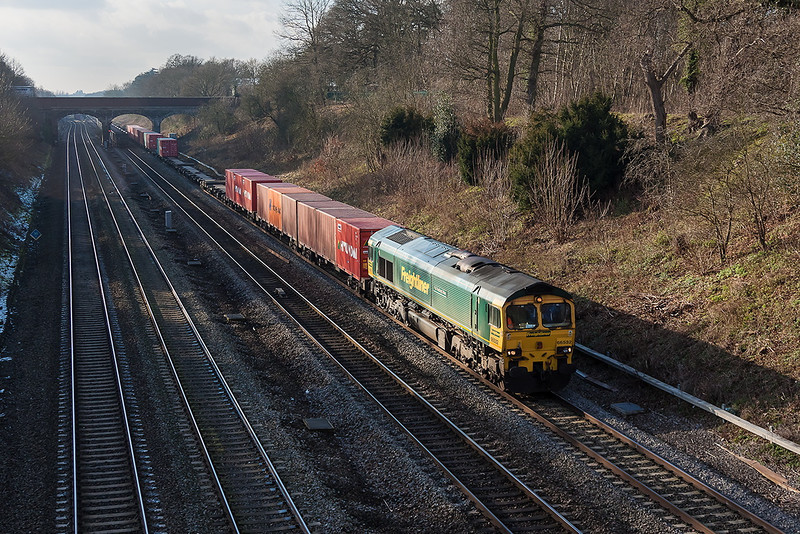 15th Jan 13:  4O24 is the Tuesday Only Freightliner service from Bristol to Thamesport.  Today powered by 66532 it is pictured from Southbury Lane in Ruscombe.  The Crawley to Pengam empty boxes can just be seen under the Stanlake Lane bridge