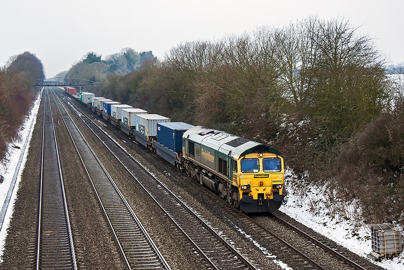 23rd Jan 13:   The Bristol Freightliner Terminal to Felixstwe in the hands of 66503 trundles up the relief through Shottesbrooke on a very mucky day